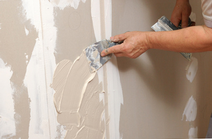 Old sheetrock is being replaced with new impact resistant models